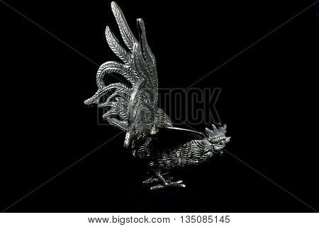 Silver Metal Cockerel Statue on Black Background