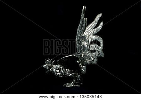 Silver Metal Cockerel Statue on Black Background