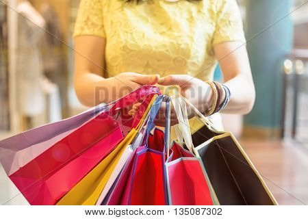 Woman holding her shopping bags in both hands