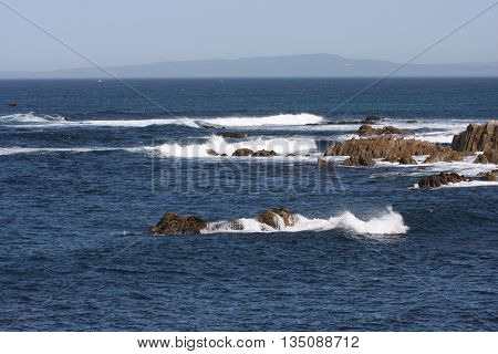 This is an image of waives and rocks at Asilomar State Preserve in Pacific Grove, California, U.S.A.