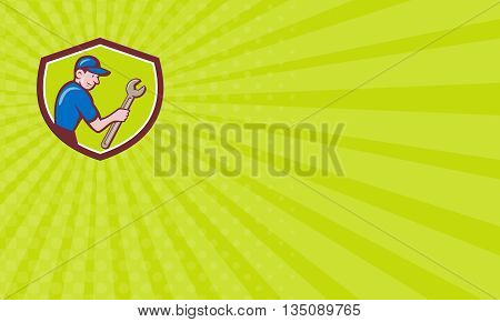 Business card showing illustration of a repairman handyman worker wearing hat carrying spanner wrench looking to the side set inside shield crest done in cartoon style.