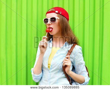 Portrait Pretty Cool Girl With Lollipop Over Green Background