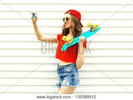 Pretty Cool Smiling Girl Makes Self Portrait On Smartphone Over