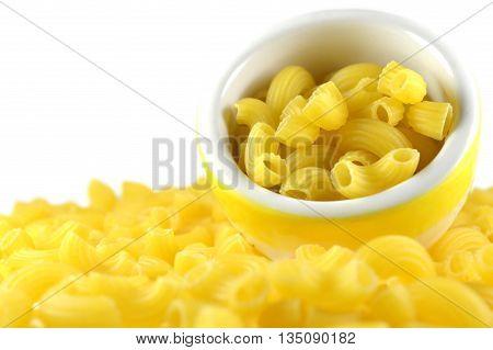 Elbow macaroni, narrow tube-shaped, on white background