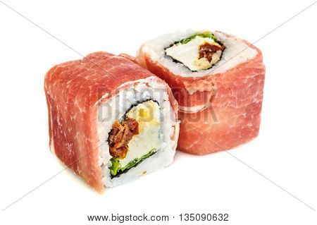 Uramaki maki sushi with prosciutto crudo, two rolls isolated on white. Letuce, philadelphia cheese, dried tomatoes, parmigiano