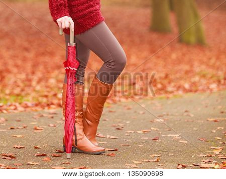 Closeup Of Woman In Brown Boots With Umbrella.