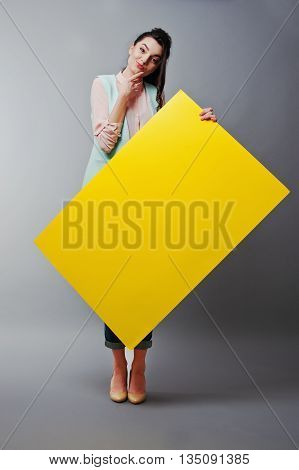 Young Girl With Face Hold Yellow Blank Paper. Young  Woman Show Blank Card. Girl With Long Hair Port