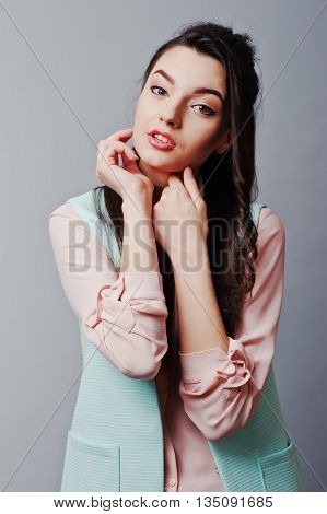 Close Up Face Portrait Of Young Brunette Girl Wearing In Pink Blouse, Turquoise Jacket, Ripped Jeans
