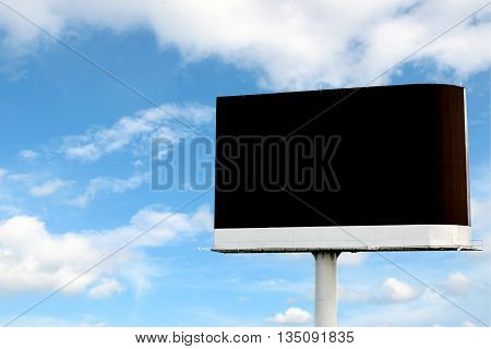 Large LED billboard for rent with blue sky background.