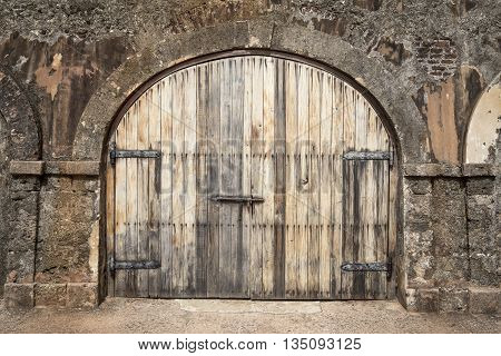 Big wooden hall door in a rustic stud farm