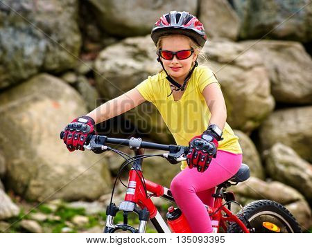 Bicycle girl rides into mountains. Girl wearing helmet and gloves on bicycle in mountaineering . Mountaineering travel bicycle is good for health.