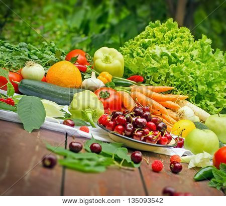 Healthy eating - organic fruit and vegetable on table