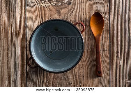Spoon with empty cooker on a table