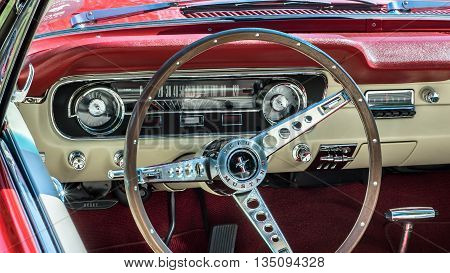 GROSSE POINTE SHORES MI/USA - JUNE 19 2016: Close up of a 1964 1/2 Ford Mustang dashboard at the EyesOn Design car show, held at the Edsel and Eleanor Ford House, near Detroit, Michigan.