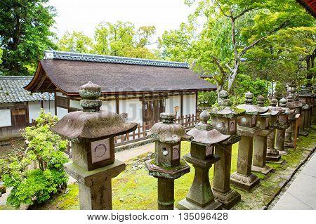 Many stone lanterns on the road leading to Kasuga shrine in Nara, Japan