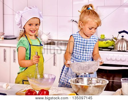 Alone children cooking breakfast at home kitchen. Children cooking dough.