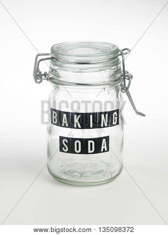 empty baking soda jar on the white background
