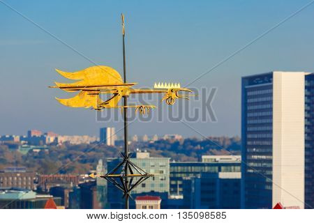 Golden Cockerel weather vane and modern office buildings skyscrapers in the background in Tallinn in the day, Estonia