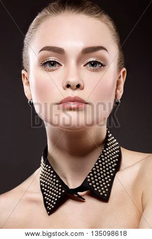Beautiful woman with evening makeup long straight hair . Smoky eyes. Fashion photo.
