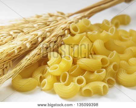 macaroni and wheat straw on the white background