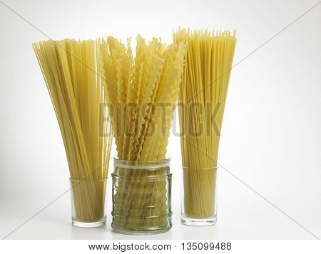 spaghetti,lasagnette and fettuccine on the white background
