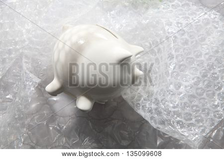 piggy bank protect by using bubble wrap