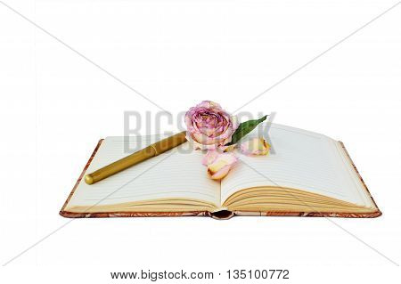 Dry roses and old diary isolated on white background.