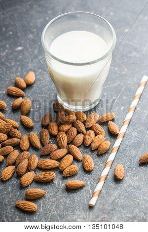 Almond milk and almonds. Tasty milk in glass.