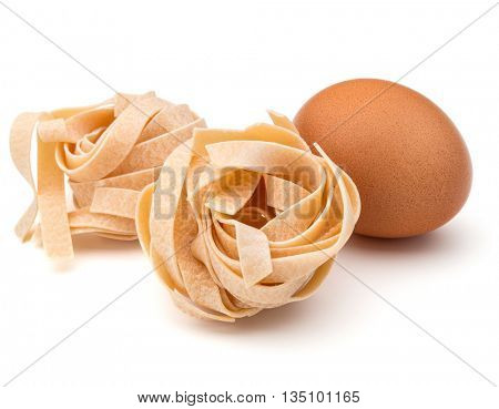 Italian pasta fettuccine nest and egg still life isolated on white background