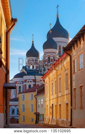 Russian Orthodox Alexander Nevsky Cathedral and narrow street of Old Town Toompea in the evening, Tallinn, Estonia
