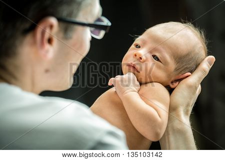 Happy Father Holding With Love His New Born Son