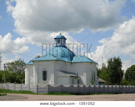 White Church And Blue Sky With Cloudes