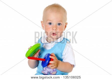 blonde hair baby boy holds toy on white background close-up portrait
