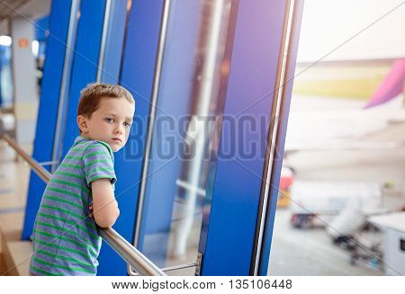 7 Years Old Boy Waiting For His Plane At Airport.