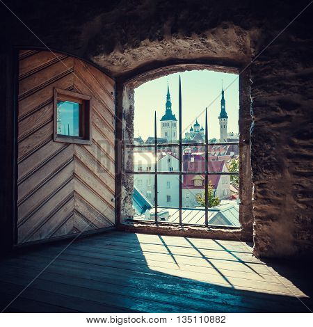 View Of Old Tallinn City From The Window Of Medieval Tower