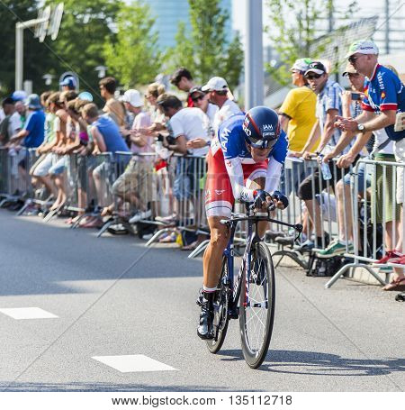 Utrecht, Netherlands - 04 July 2015: The French cyclist Jerome Coppel of IAM Cycling Team riding during the first stage (individual time trial ) of Le Tour de France 2015 in Utrecht Netherlands on 04 July 2015.