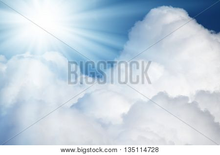 A bright flash of blue star in the sky among the rich white clouds