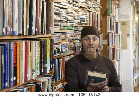 Person in books and antique store