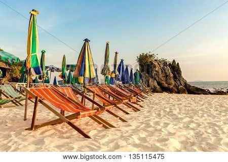 Beach chairs on the white sand beach.