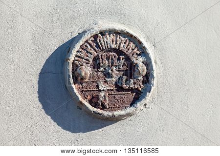 The old geodetic sign on the wall of building in St. Petersburg Russia