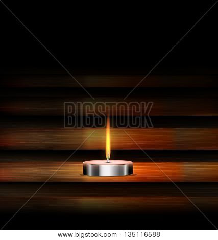 dark background and burning candle on the wooden stand