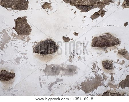 Background of old damaged stone wall in oldtown texture