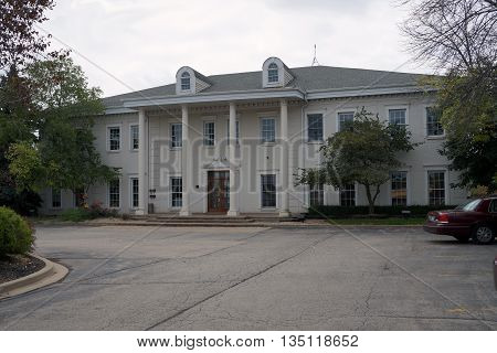 SHOREWOOD, ILLINOIS / UNITED STATES - AUGUST 30, 2015: The office of Dr. J. Pediatrics is inside a large colonial building in Shorewood.