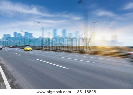 motion traffic on highway wity city backgroundï¼?chongqing china.