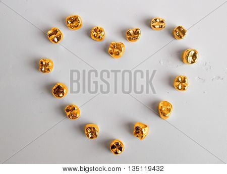 Flat lay tooth crown on surface background