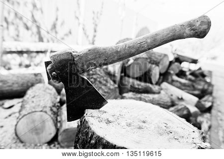 Axe In Stump. Black And White Photo.