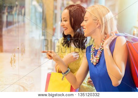 Woman showing her friend something that she wants
