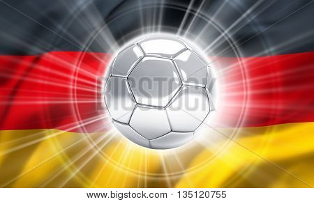Silver soccer ball illuminated on a flag of Germany
