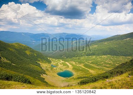 Mountain Landscape with Blue Lake in sunny summer day, Carpathian, Ukraine, Europe