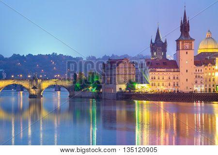 Famous Prague Landmarks at night time with city illuminated, Czech, Europe